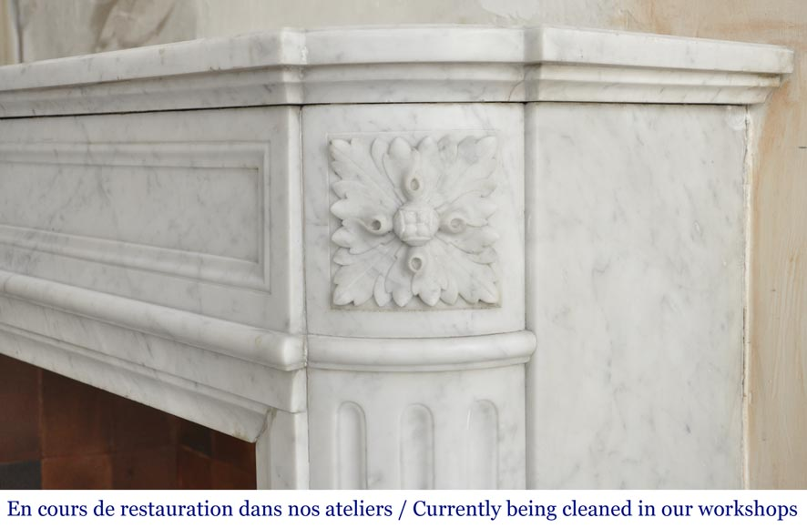 An antique Louis XVI style fireplace with rounded corners, made out of Carrara marble-6
