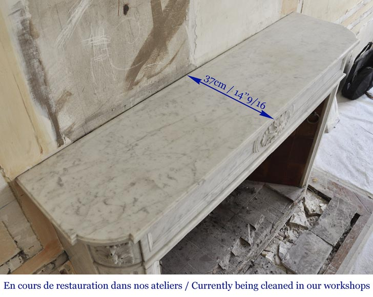 An antique Louis XVI style fireplace with rounded corners, made out of Carrara marble-8