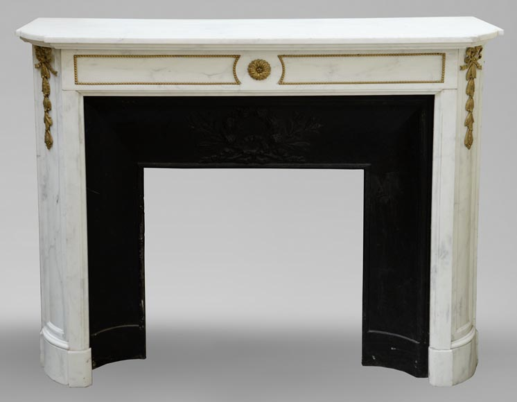 An antique Louis XVI style fireplace made out of Carrara marble with gilded bronze ornaments-0