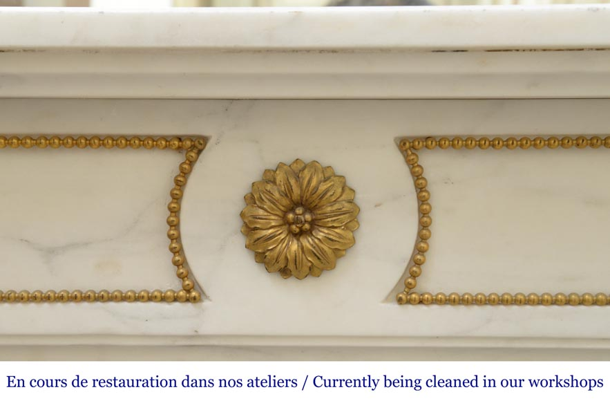 An antique Louis XVI style fireplace made out of Carrara marble with gilded bronze ornaments-1
