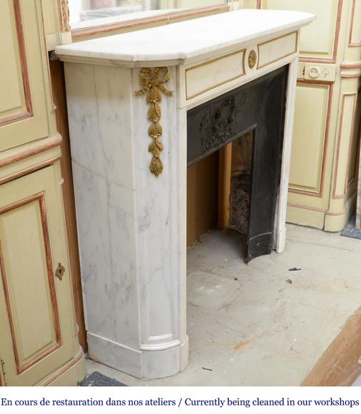An antique Louis XVI style fireplace made out of Carrara marble with gilded bronze ornaments-2