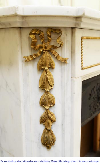 An antique Louis XVI style fireplace made out of Carrara marble with gilded bronze ornaments-3