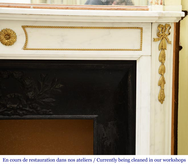 An antique Louis XVI style fireplace made out of Carrara marble with gilded bronze ornaments-6