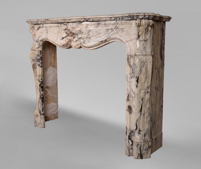 An antique Louis XV style fireplace with three shells, made out of Serravezza Breccia marble-6