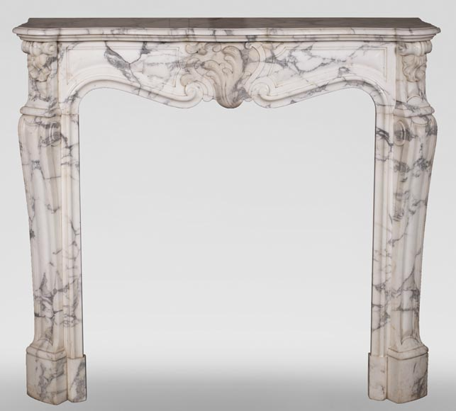 An antique Louis XV style fireplace, with a large asymmetrical shell, made out of Arabescato marble-0