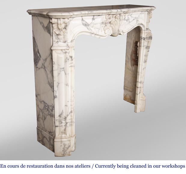 An antique Louis XV style fireplace, with a large asymmetrical shell, made out of Arabescato marble-3