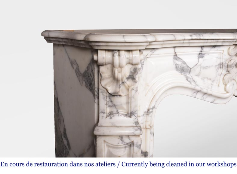 An antique Louis XV style fireplace, with a large asymmetrical shell, made out of Arabescato marble-4