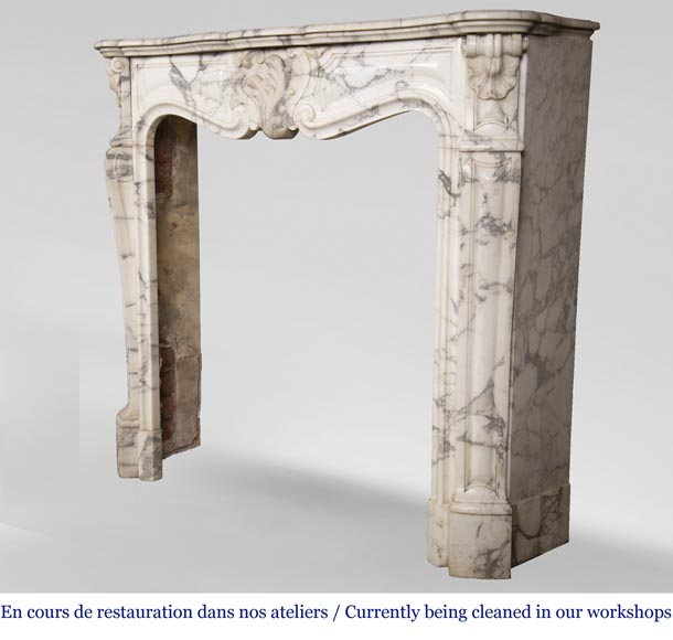 An antique Louis XV style fireplace, with a large asymmetrical shell, made out of Arabescato marble-6