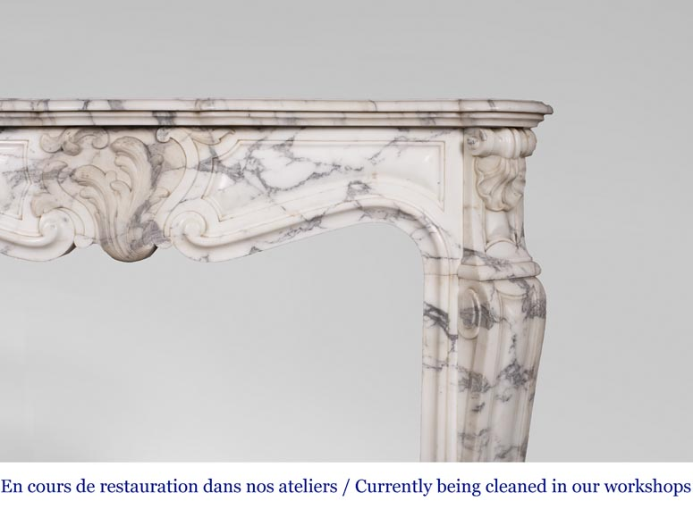 An antique Louis XV style fireplace, with a large asymmetrical shell, made out of Arabescato marble-7