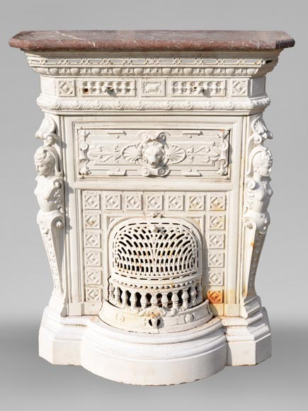Antique cast iron stove in the Napoleon III style decorated with caryatids-0