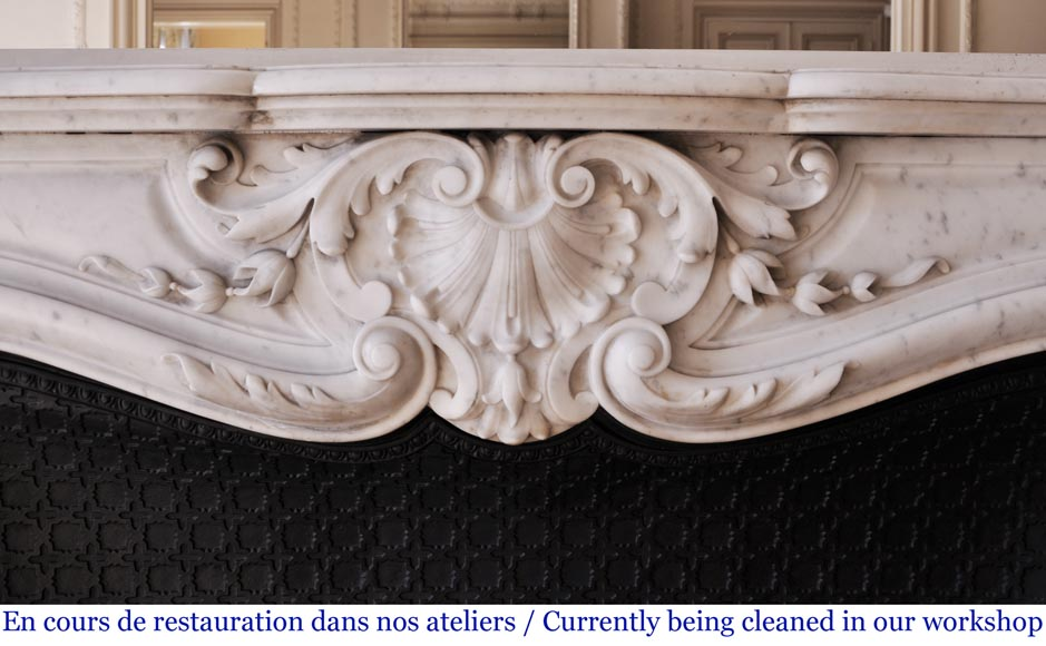 An antique Louis XVI style fireplace made out of Carrara marble-1