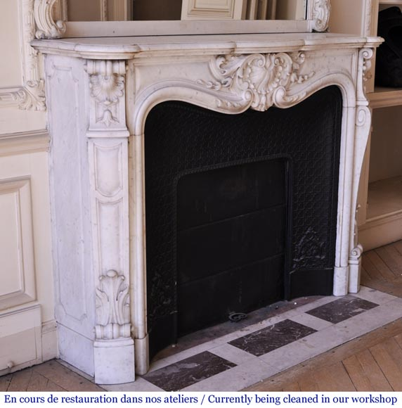 An antique Louis XVI style fireplace made out of Carrara marble-4