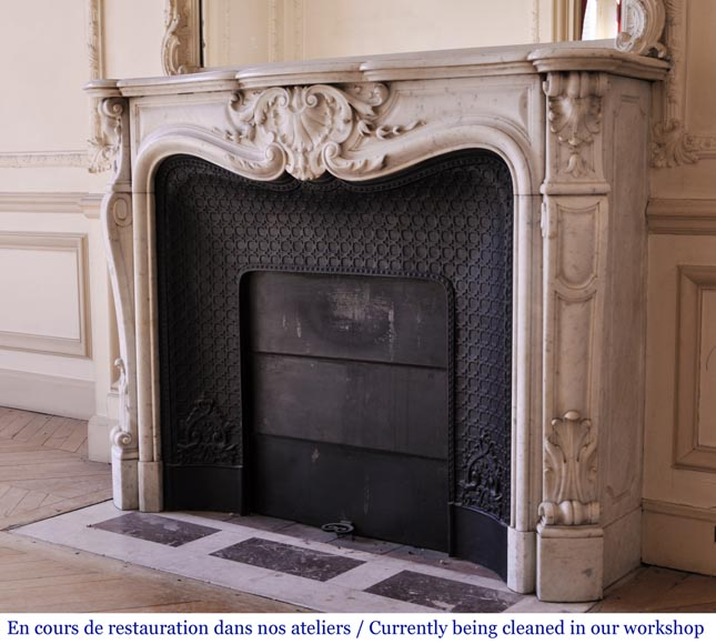 An antique Louis XVI style fireplace made out of Carrara marble-7