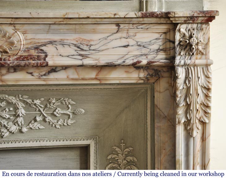 An antique Louis XVI style fireplace in Onyx marble-7