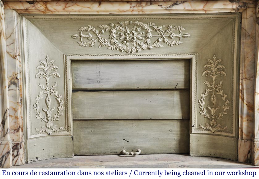An antique Louis XVI style fireplace in Onyx marble-9