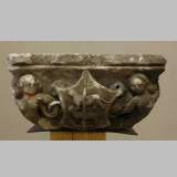 Gothic stone capital with coat of arms