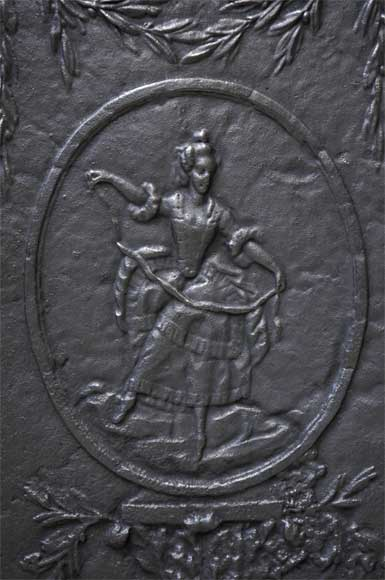 Antique cast iron fireback with a dancer-1