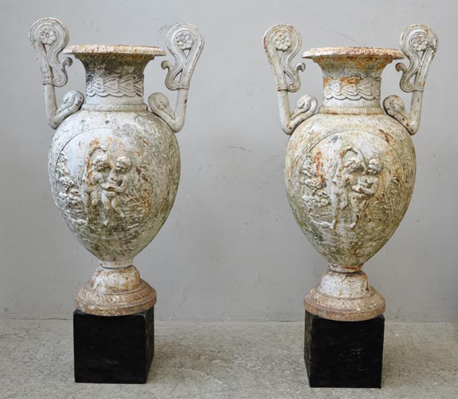 Antique pair of cast iron vases with putti-0
