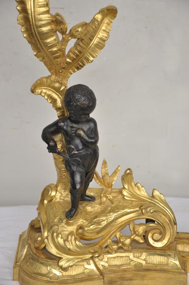 Antique bronze firedog with exotic figures.-3