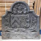 Antique cast iron fireback with two coat of arms