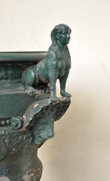 Antique cast iron vase with two sphinxes