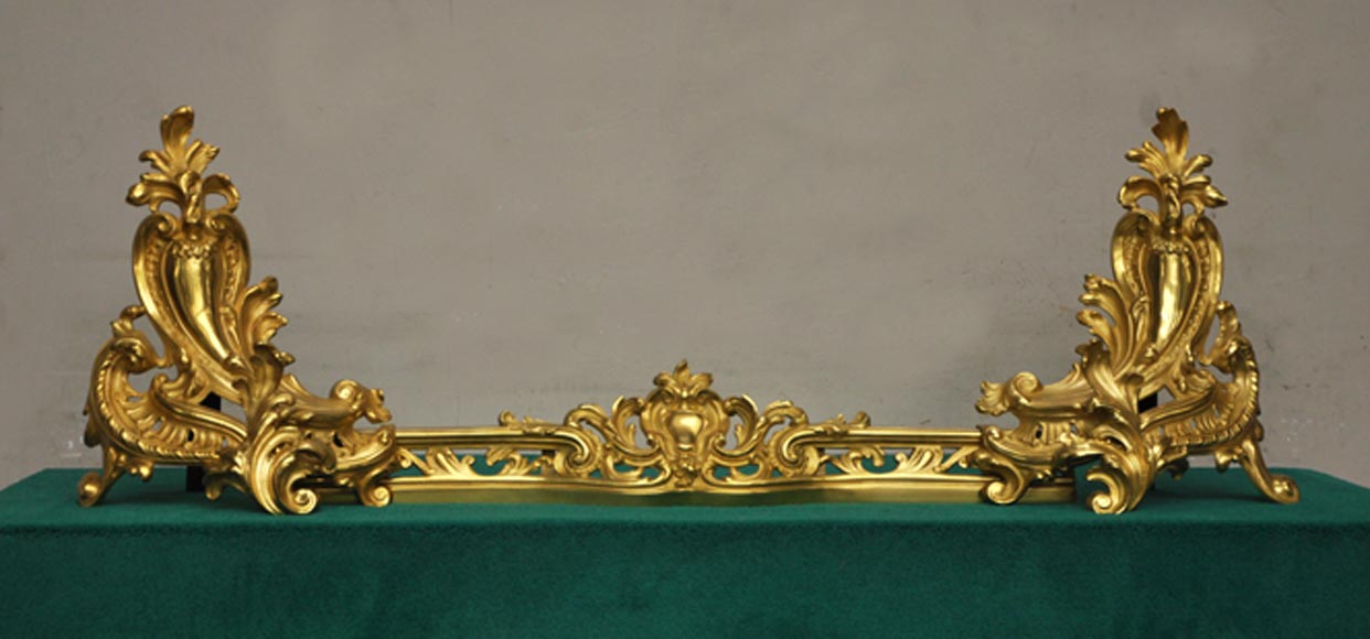 Antique Louis XV style andirons in gilded bronze - Reference 9952
