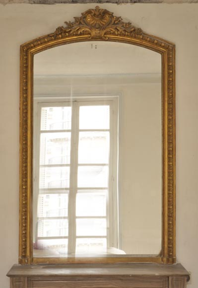 Antique Louis XV style pierglass with a shell decor in a gilded stucco frame - Reference 9961